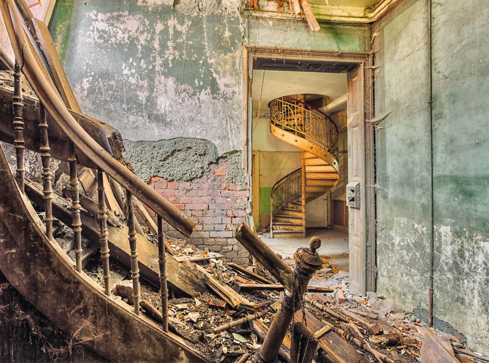 decay spiral staircase in door frame