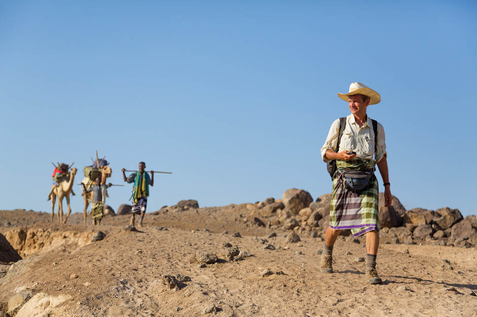 Paul Salopek and his team walking out of the desert to begin day 19 of Out of Eden walk somewhere between Mille and Logiya in the Afar region of Northeast Ethiopia.