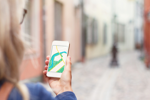 tourist-with-map-app-phone-shutterstock-510px