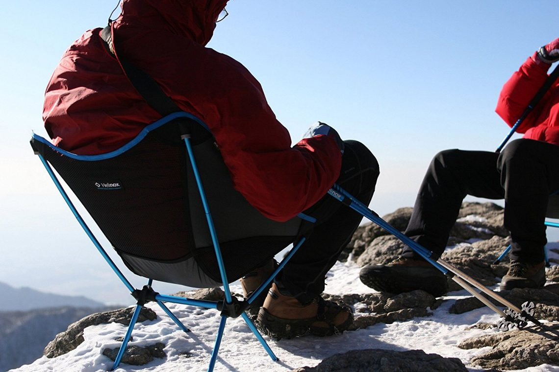 hikers-sitting-in-camping-chairs-on-snow